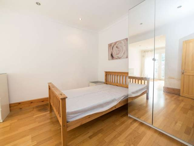 Decorated room in 5-bedroom flat in Newham, London