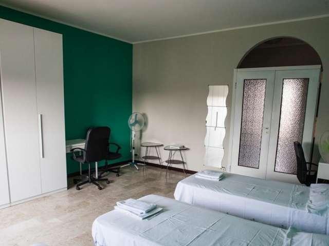Beds in room in apartment in Tibaldi, Milan