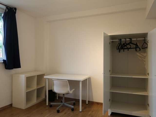 Warm room in 7-bedroom apartment in Anderlecht, Brussels