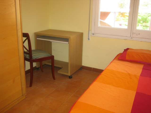 Sunny room in 10-bedroom apartment in Les Corts, Barcelona