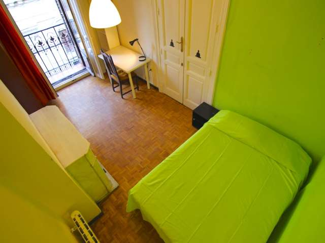 Lively room in shared apartment in Latina, Madrid
