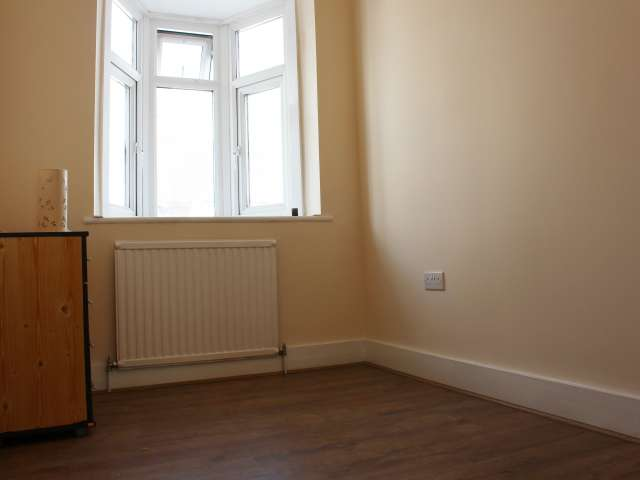 Decorated room in shared flat in Tottenham, London