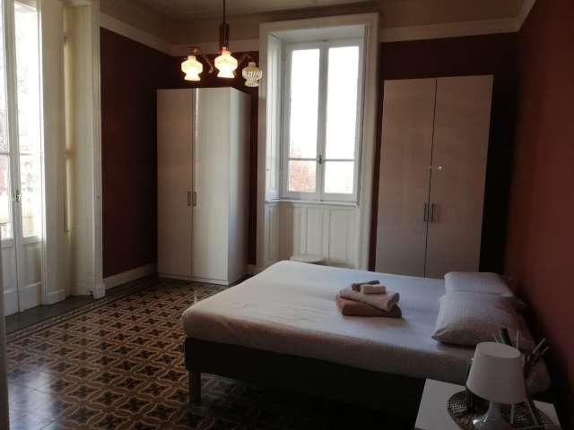 Chill room in affitto in appartamento con 2 camere da letto a Isola