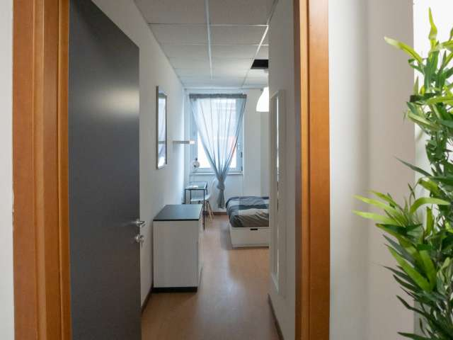 Spacious room for rent in 12-bedroom apartment in Bicocca