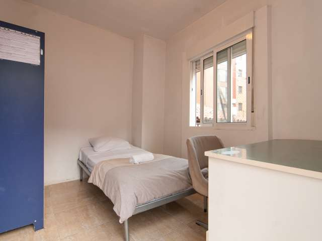 Bright room in 10-bedroom apartment in Les Corts, Barcelona
