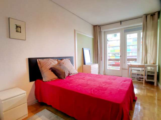 Room with balcony in 8-bedroom apartment in Madrid
