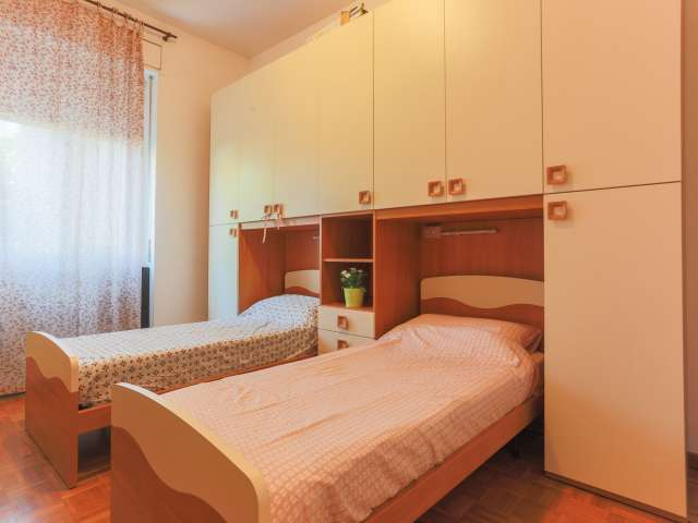 Beds in modern shared room in 4-bedroom apartment, Ticinese