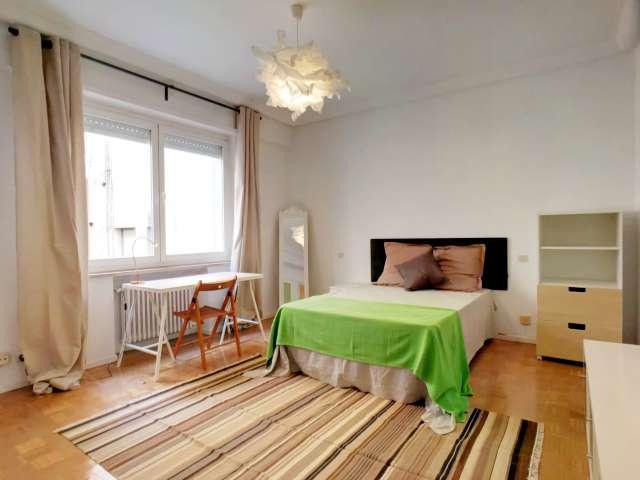 Spacious room in 8-bedroom apartment in Nueva España, Madrid