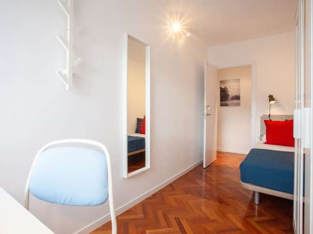 Cool room for rent in 10-bedroom flat in Ciudad Lineal