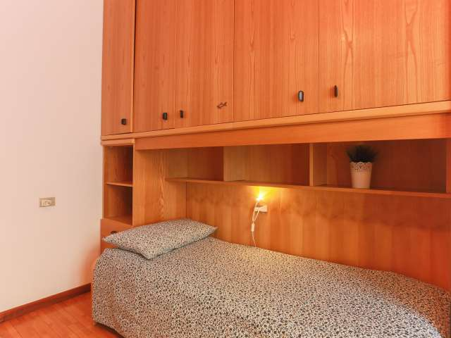 Beds in tidy shared room in 4-bedroom apartment in Ticinese