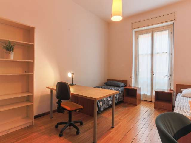 Beds in bright shared room in 4-bedroom apartment, Ticinese