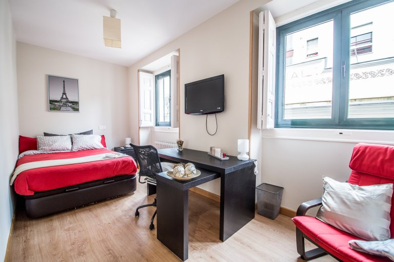 Huge room for rent in shared apartment in Malasaña