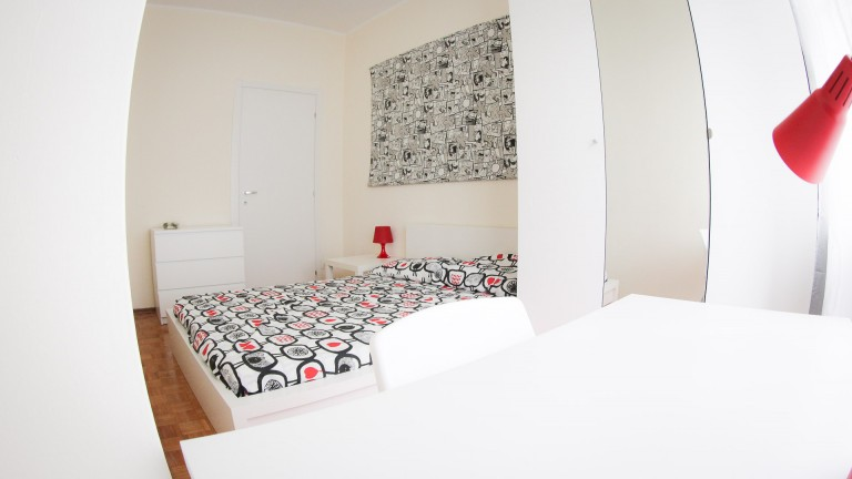 Bedroom 2 with double bed and heating unit