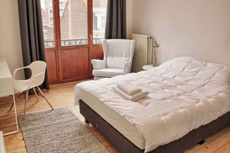 Bedroom 6 with double bed and balcony