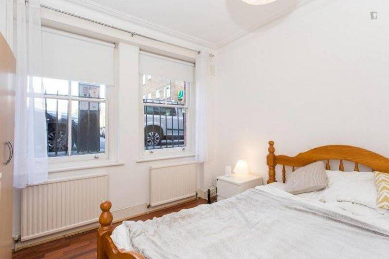 Quarto decorado em apartamento de 3 quartos em Barnsbury, Londres
