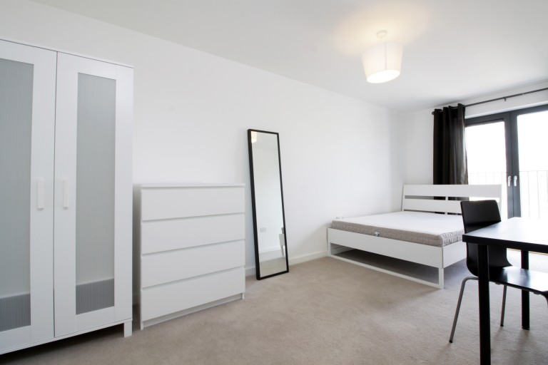 Bedroom 6 with a double bed and a balcony