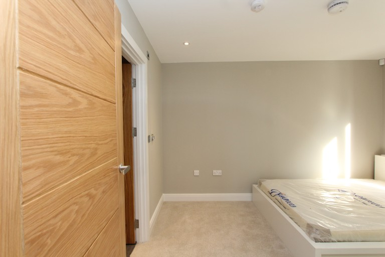 Bedroom 2 with double bed and ensuite
