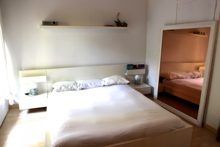 Bedroom 1 with double bed, dressing room and balcony