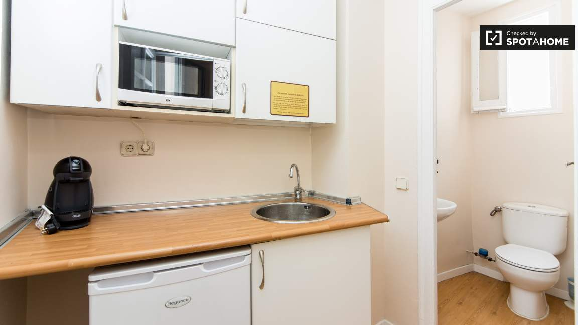 Kitchen near the library, and toilet