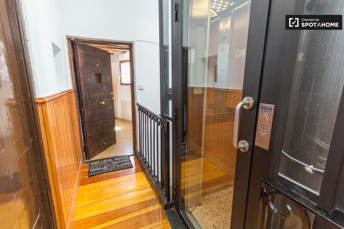 Elevator close to you door.