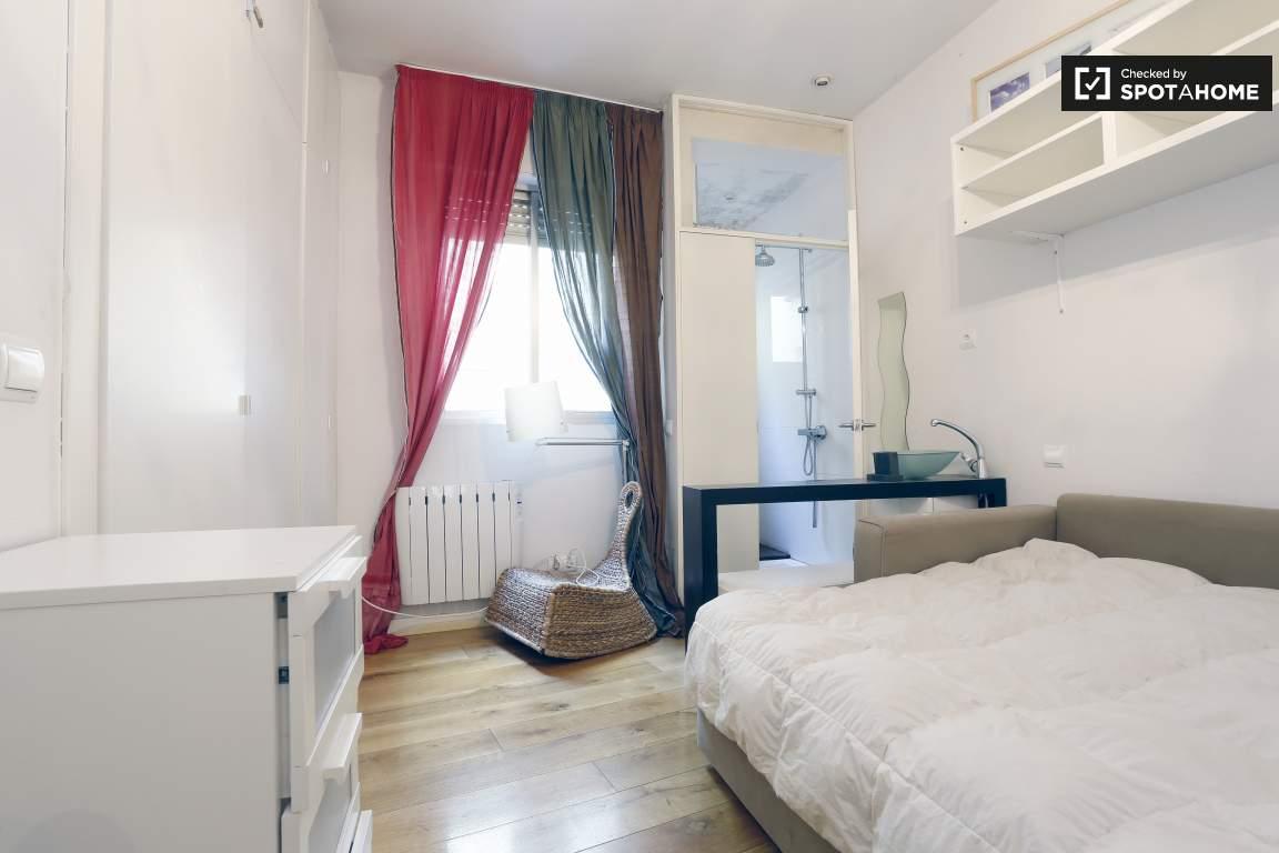 bedroom 1 view of bathroom