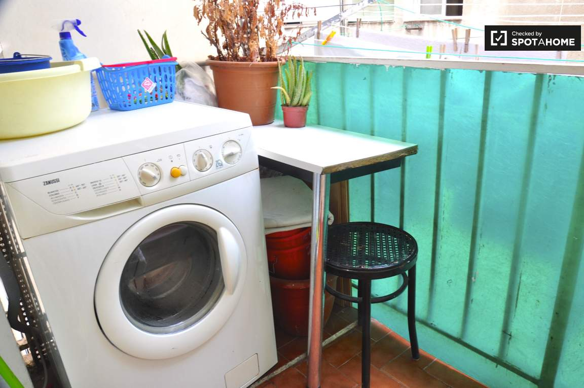 Laundry area/Balcony