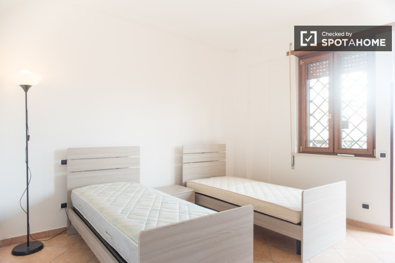 Bedroom 2 with Twin Beds and Balcony