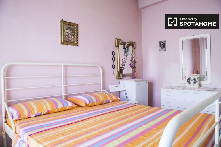 Colourful room for rent in 2-bedroom apartment in Casilino