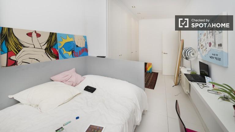 Interior double bedroom with huge TV
