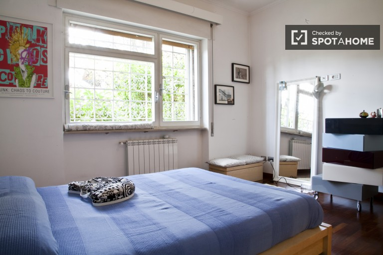 Bedroom with double bed and garden views