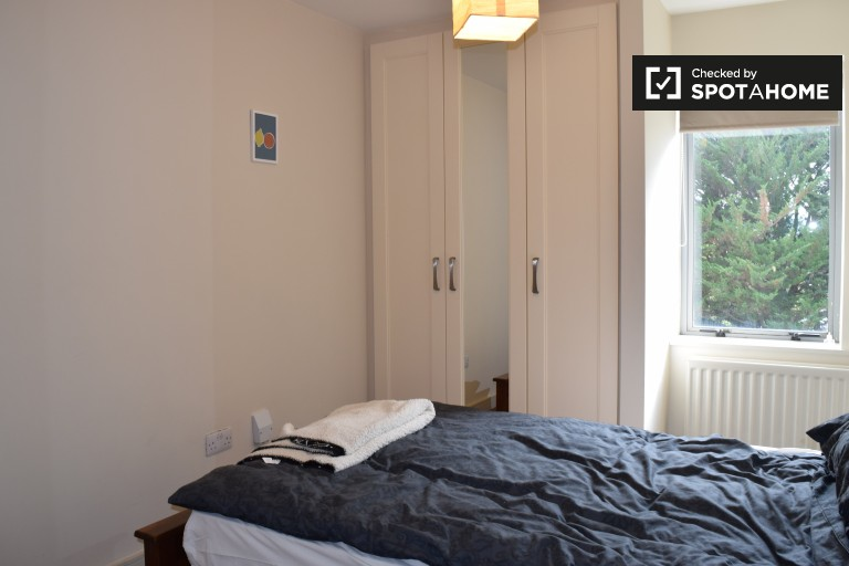 Bedroom 1 with double bed and private bathroom