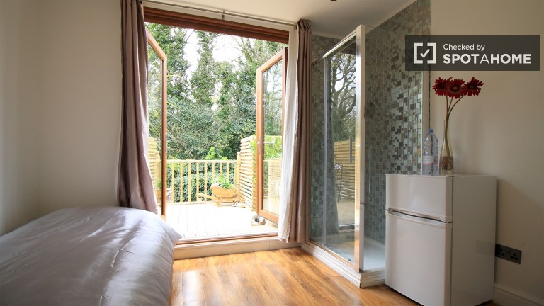 Bedroom 3 with small double bed, balcony and private shower