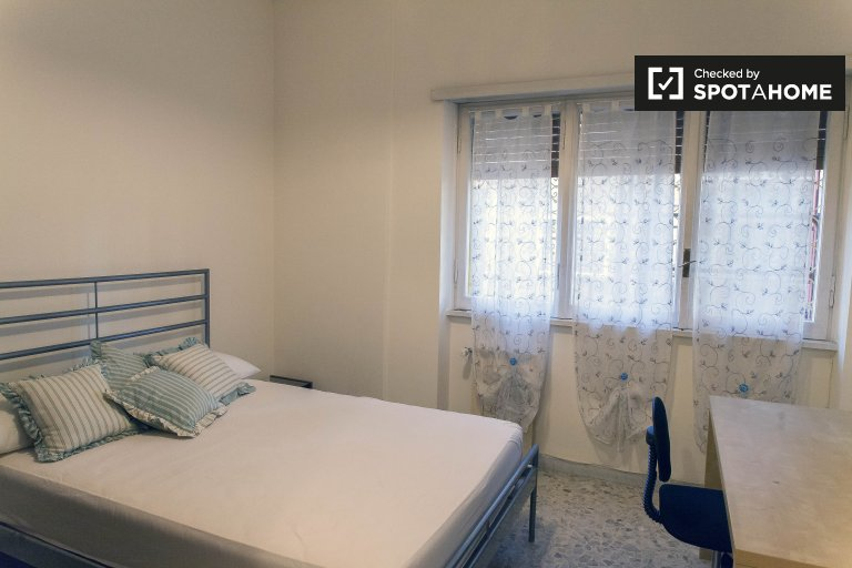 Double Bed in Beds and rooms for rent in a furnished 3-bedroom apartment with balcony in Aurelio