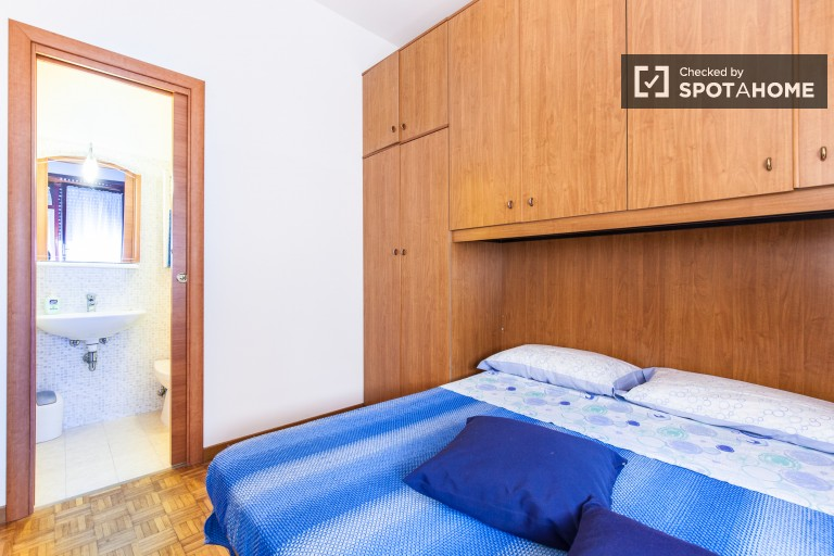 Bedroom 2 with double bed and private bathroom