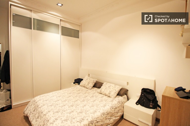 Bedroom 1 with double bed and private en-suite bathroom