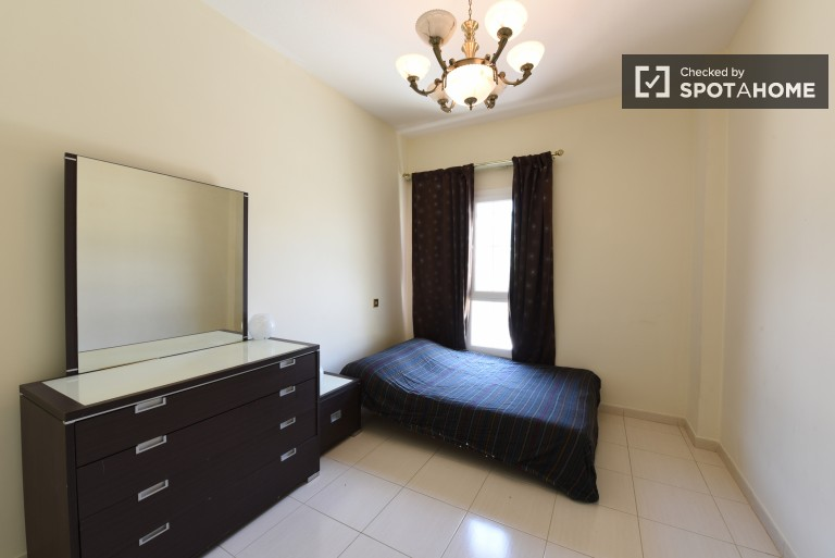 Bedroom 1 with double bed and AC