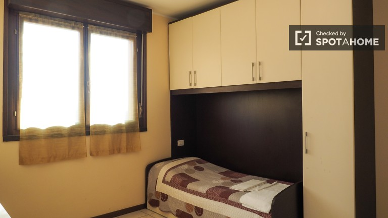 Bedroom 2 with Single Bed and Private Kitchen and Sink