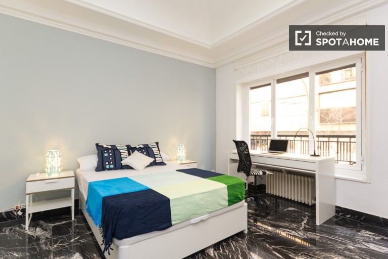 Bedroom 1 with double bed and exterior view