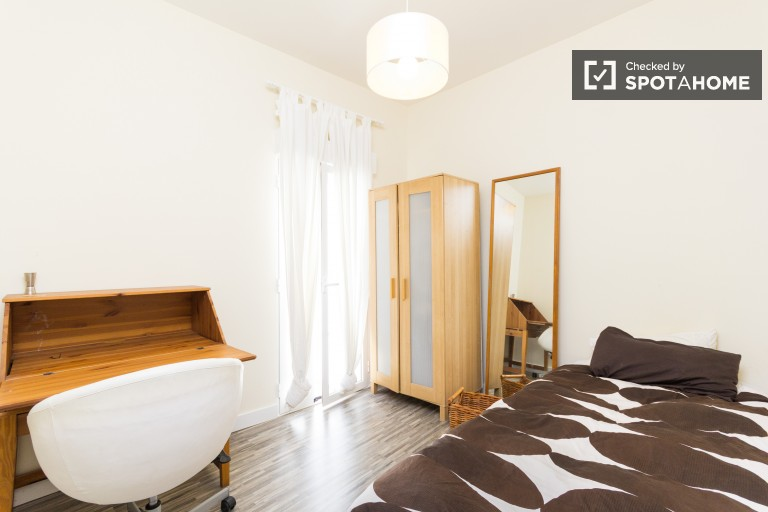 Bedroom 1 with single bed and private bathroom