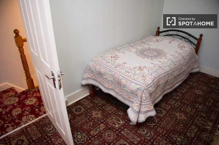 Bedroom 1 with large single bed and TV