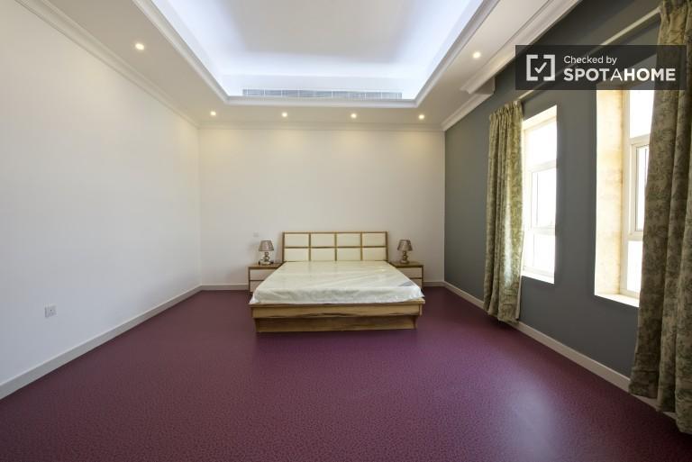 Bedroom 2 with purple floor