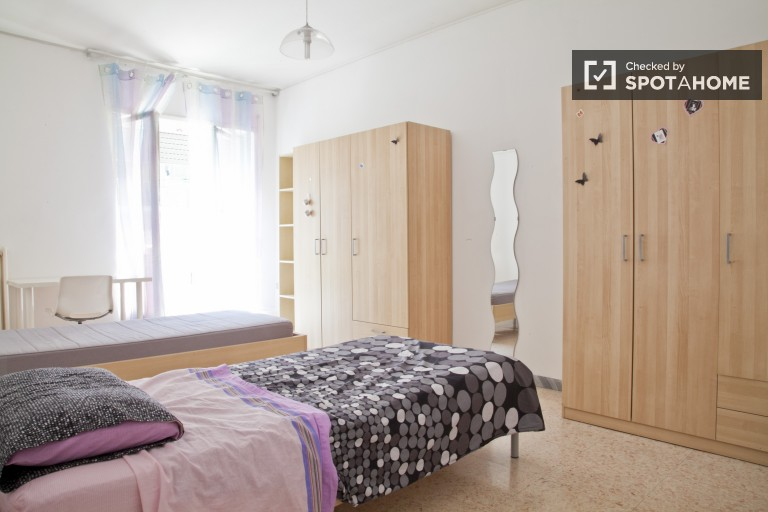 Bedroom 1 with 2 beds for rent in a shared occupancy bedroom with balcony
