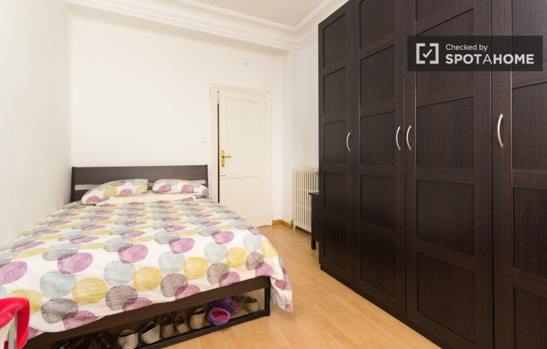 Bedroom 2 with double bed, television and air-conditioning
