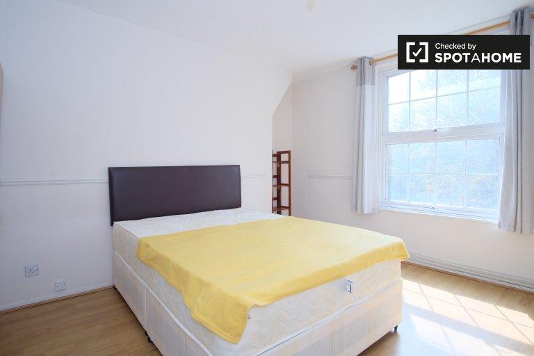 Se alquila habitación en un apartamento de 4 habitaciones, Islington, Londres.