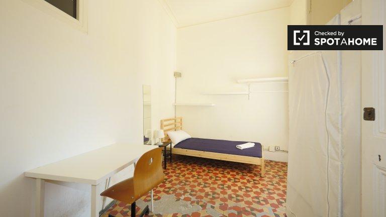 Sunny room in 7-bedroom apartment in Barri Gòtic, Barcelona