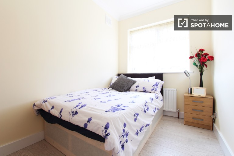 Bedroom 2 with double bed and garden view