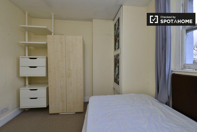 Quarto acolhedor em apartamento compartilhado em Shepherds Bush, Londres
