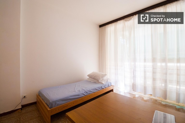 Bedroom 1, couple-friendly with single bed and balcony