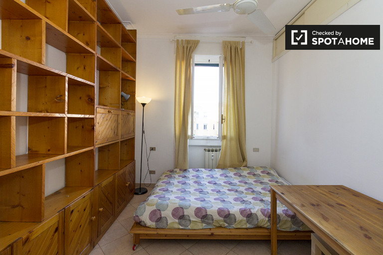 Bedroom 3 with double bed and walk-in wardrobe.