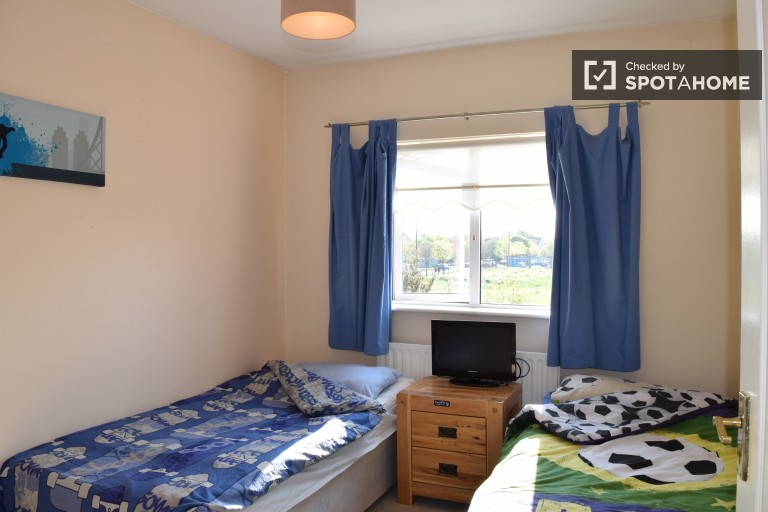 Bedroom 1 with twin beds and heating unit